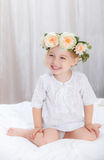 Happy little girl on a bed Stock Images