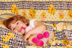 Happy little girl bedtime Royalty Free Stock Photos