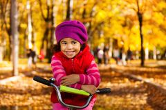 Happy little girl on bicycle Royalty Free Stock Image