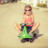 Happy little girl on the bicycle Royalty Free Stock Photography
