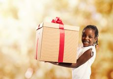 Happy little girl with a Christmas gift stock images