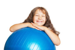 Happy little girl with big fitness ball. Royalty Free Stock Photo