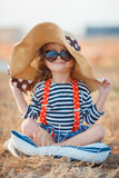 The happy little girl in a big hat Royalty Free Stock Image