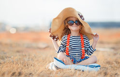 The happy little girl in a big hat Stock Photography