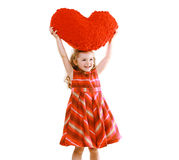 Happy little girl with big heart Royalty Free Stock Images