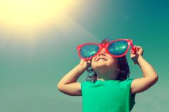 Happy little girl with big sunglasses stock photography