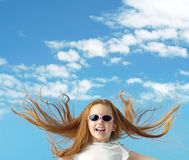 Happy little girl with big sunglasses Stock Photo