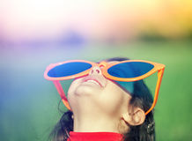 Happy little girl with big sunglasses Royalty Free Stock Photography