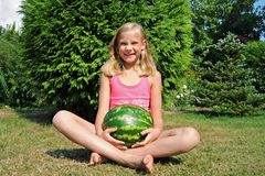 Happy little girl with a big watermelon royalty free stock photos