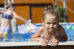 Happy little Girl in bikini swimming pool royalty free stock image