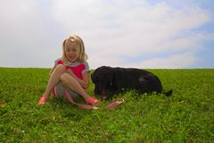 Happy Little Girl and Black Lab Royalty Free Stock Images