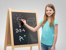 Happy little girl with blackboard and chalk Stock Photography