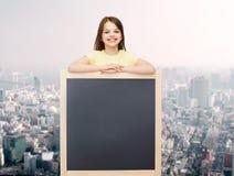 Happy little girl with blank blackboard Royalty Free Stock Photo