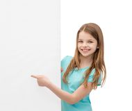 Happy little girl with blank white board Stock Image