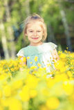 Happy little girl on blooming meadow Stock Photo