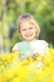 Happy little girl on blooming meadow Royalty Free Stock Photography