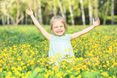 Happy little girl on blooming meadow Royalty Free Stock Photos