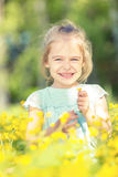 Happy little girl on blooming meadow Royalty Free Stock Photo