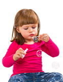 Happy little girl blowing bubbles Royalty Free Stock Photography