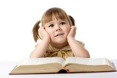 Happy little girl with book, back to school Royalty Free Stock Photos