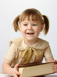 Happy little girl with book, back to school Stock Images