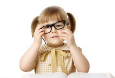 Happy little girl with book wearing black glasses Stock Photography
