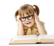 Happy little girl with book wearing black glasses Stock Photo