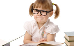 Happy little girl with book wearing black glasses Royalty Free Stock Image