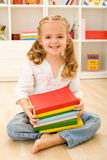 Happy little girl with books Stock Photo
