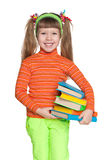 Happy little girl with books Royalty Free Stock Photography