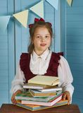 Happy little girl  with books Royalty Free Stock Photo