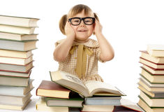 Happy little girl with books wearing black glasses Royalty Free Stock Image