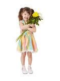 Happy little girl with bouquet of flowers Stock Image