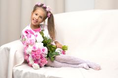 Little girl with a bouquet of flowers Stock Images