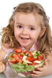 Happy little girl with a bowl of fruit salad Royalty Free Stock Image