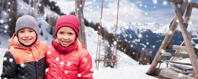 Happy little girl and boy over winter Stock Photo