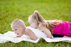 Happy little girl and boy in a park Royalty Free Stock Images