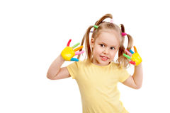 A happy little girl with brightly painted fingers. Isolated on white background stock photography