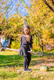 Happy little girl with broom wearing witch costume Royalty Free Stock Photography