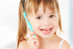 Happy little girl brushing her teeth Stock Image