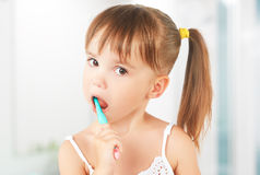 Happy little girl brushing her teeth Royalty Free Stock Images