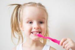 Happy Little Girl Brushing Her Teeth, Pink Toothbrush, Dental Hygiene Morning Night stock photo