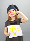 An happy little girl with a bulb painted; concept of good idea Stock Images