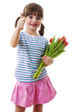 Happy little girl with bunch of flowers Royalty Free Stock Photos