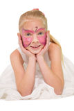 Happy little girl in butterfly face paint Royalty Free Stock Photos