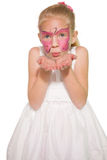 Happy little girl in butterfly face paint Royalty Free Stock Photo