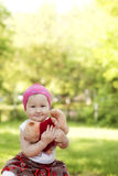 Happy little girl in cap playing with Teddy bear Royalty Free Stock Photo
