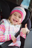 Happy little girl in the car Stock Photo