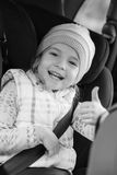Happy little girl in the car Royalty Free Stock Photos