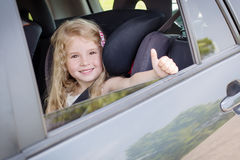 Happy little girl in the car Royalty Free Stock Images